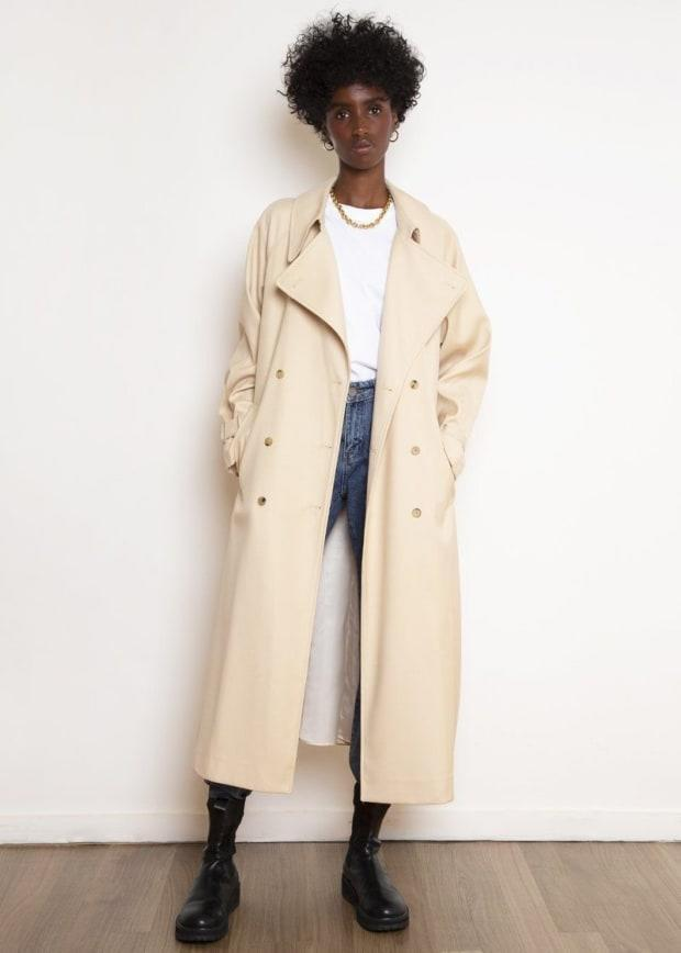 "<p>The Frankie Shop Classic Woven Trench Coat in Buff, $395, <a href=""https://thefrankieshop.com/collections/outerwear/products/classic-woven-trench-in-buff"" rel=""nofollow noopener"" target=""_blank"" data-ylk=""slk:available here"" class=""link rapid-noclick-resp"">available here</a>. </p>"