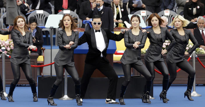 South Korean rapper PSY, third left, performs with dancers before the inauguration ceremony of President Park Geun-hye at the National Assembly in Seoul, South Korea, Monday, Feb. 25, 2013. Park took office as South Korea's first female president Monday, returning to the presidential mansion she had known as the daughter of a dictator, and where she will respond to volatile North Korea, which tested a nuclear device two weeks ago. (AP Photo/Lee Jin-man)