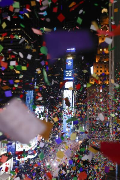 Confetti drops over the crowd as the clock strikes midnight during the New Year's celebration as seen from the New York Marriott Marquis in New York's Times Square, late Tuesday, Dec. 31, 2019. (AP Photo/Frank Franklin II)