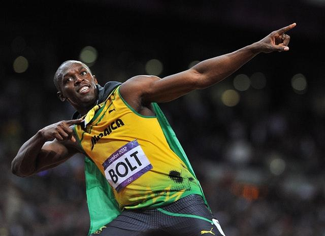 Usain Bolt celebrates after defending his men's 100m title in stunning style at London 2012, winning the final in an Olympic record time of 9.63 seconds. Seven of the eight finalists ran under 10 seconds in what was the fastest Olympic 100m final, with Jamaican Bolt clocking the second quickest time in history in front of an 80,000 capacity crowd