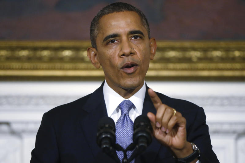 Obama lashes Republicans as government reopens