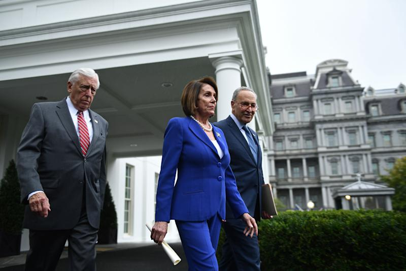 Speaker of the House Nancy Pelosi (C), Senate Minority Leader Chuck Schumer (D-NY) (R) and Representative Steny Hoyer, walk out of the White House after meeting with US President Donald Trump on October 16, 2019.