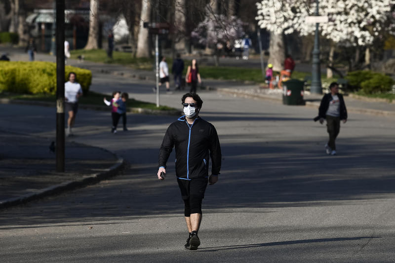 TURIN, ITALY - March 18, 2020: A person walks in a park. The Italian government imposed unprecedented restrictions to halt the spread of COVID-19 coronavirus outbreak, among other measures people movements are allowed only for work, for buying essential goods and for health reasons. walking and playing sports is allowed but not recommended, furthermore it's recommend to take your dog out only for the minimum amount of time needed. Some cities have closed parks Minister for Sport and Youth Policies Vincenzo Spadafora said that the Italian government is considering banning outdoor physical activity. (Photo by Nicol� Campo/Sipa USA)