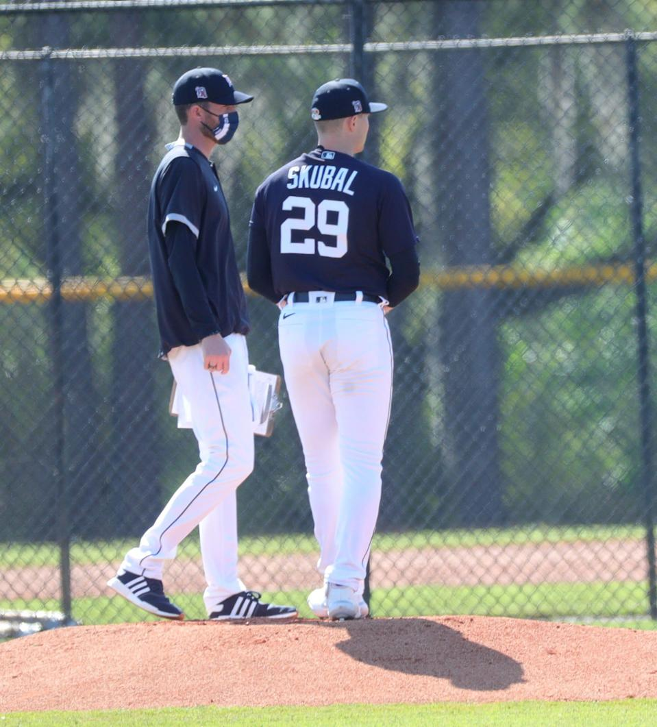 Detroit Tigers coach Chris Fetter and pitcher Tarik Skubal talk during batting practice Tuesday, Feb. 23, 2021, on the Tiger Town practice fields at Joker Marchant Stadium in Lakeland, Florida.