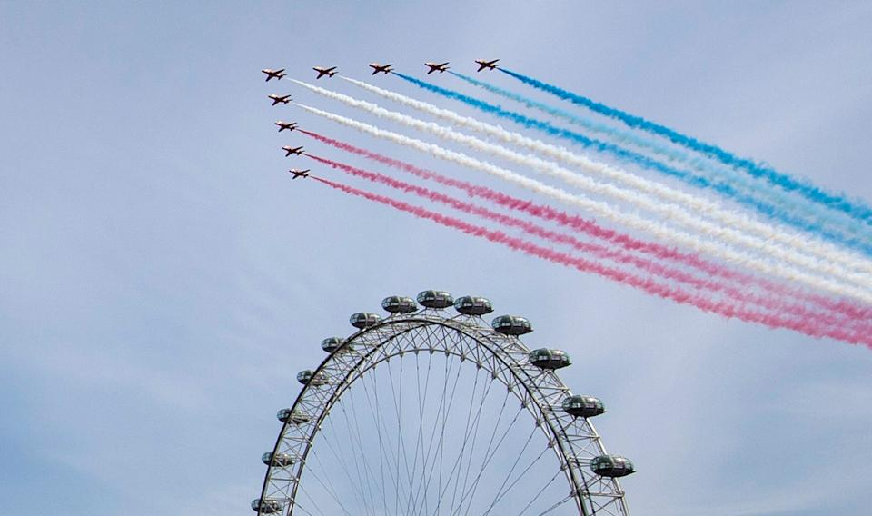 The Royal Air Force Red Arrows pass over the London Eye on the bank of the River Thames during a flypast in central London to mark the 75th anniversary of VE Day.