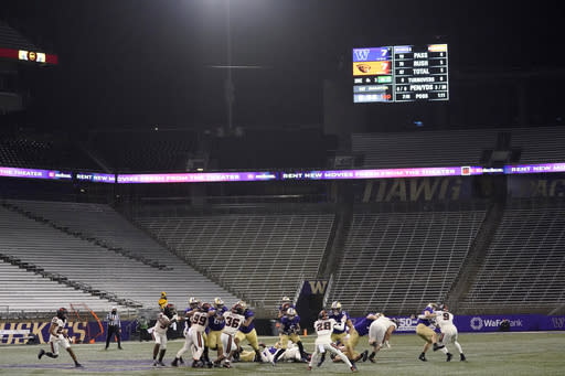 Washington running back Sean McGrew (5) rushes against Oregon State in a Husky Stadium void of fans during the coronavirus pandemic, during the first half of an NCAA college football game Saturday, Nov. 14, 2020, in Seattle. (AP Photo/Ted S. Warren)