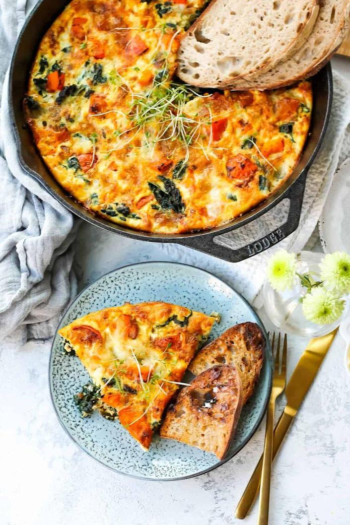 """<p>Frittatas are delicious any time of day. Serve this fall-inspired egg dish for breakfast, lunch, or even dinner.</p><p><strong>Get the recipe at <a href=""""https://www.heynutritionlady.com/roasted-pumpkin-and-kale-frittata/"""" rel=""""nofollow noopener"""" target=""""_blank"""" data-ylk=""""slk:Hey Nutrition Lady"""" class=""""link rapid-noclick-resp"""">Hey Nutrition Lady</a>. </strong> </p>"""