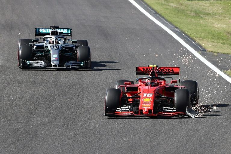 Charles Leclerc's front wing was damaged and with bits flying off in all directions, one demolishing the wing mirror of Mercedes driver Lewis Hamilton behind him (AFP Photo/Behrouz MEHRI)