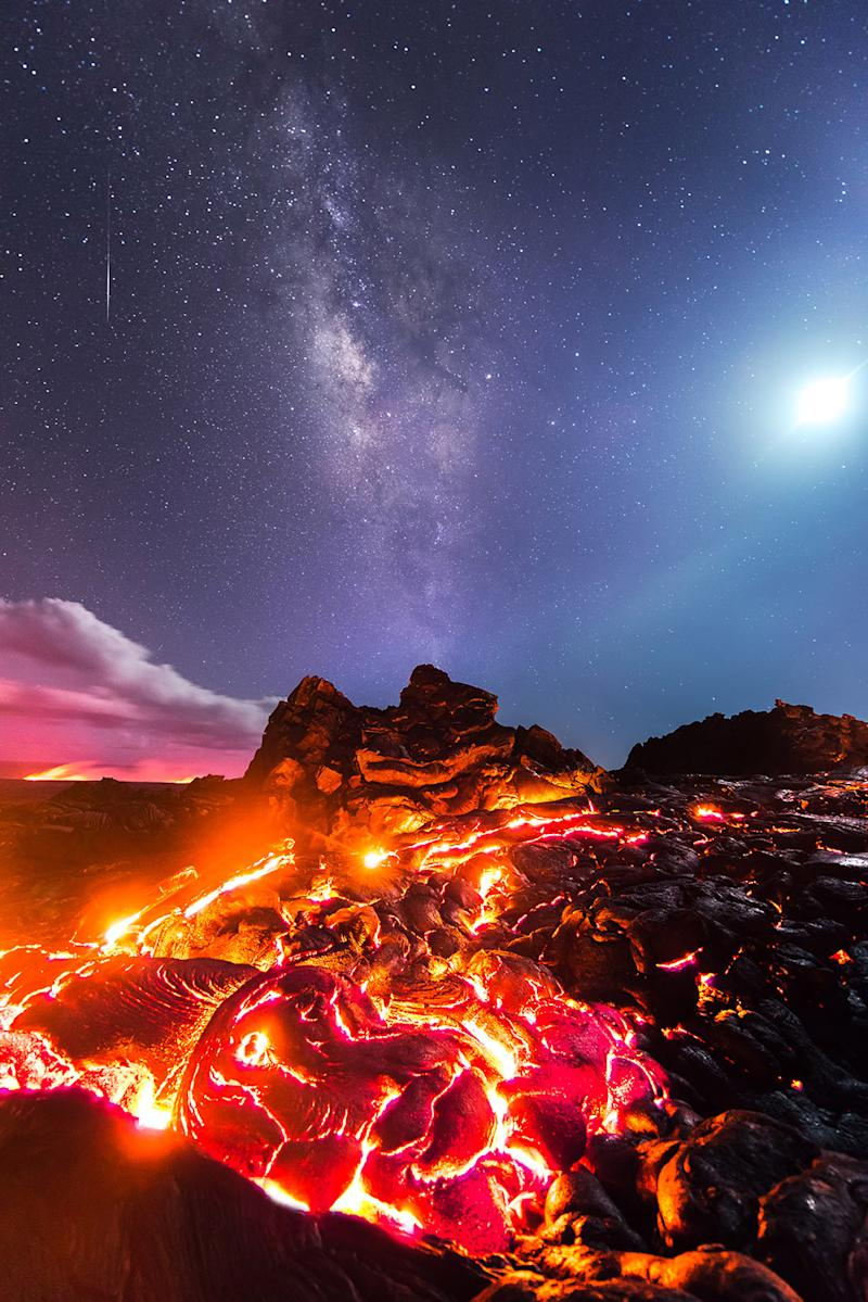 <p>Lava flows on the the Kilauea Volcano with the Milky Way a meteor and the moon above. (Photo: Mike Mezeul II/Caters News) </p>