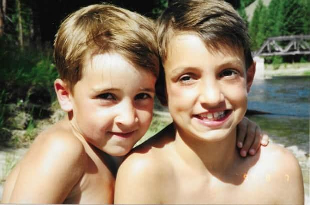 Josh MacIver, 6, left, and Gairett MacIver, 10, enjoying the sun on Aug. 7, 1997. Both brothers aspired to a career in medicine.   (Submitted by Kate McWilliams - image credit)