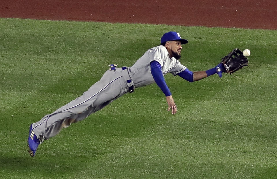 Kansas City Royals center fielder Billy Hamilton catches a ball hit by New York Yankees' DJ LeMahieu for a sacrifice fly during the sixth inning of a baseball game Friday, April 19, 2019, in New York. Yankees' Aaron Judge scored on the play. (AP Photo/Frank Franklin II)