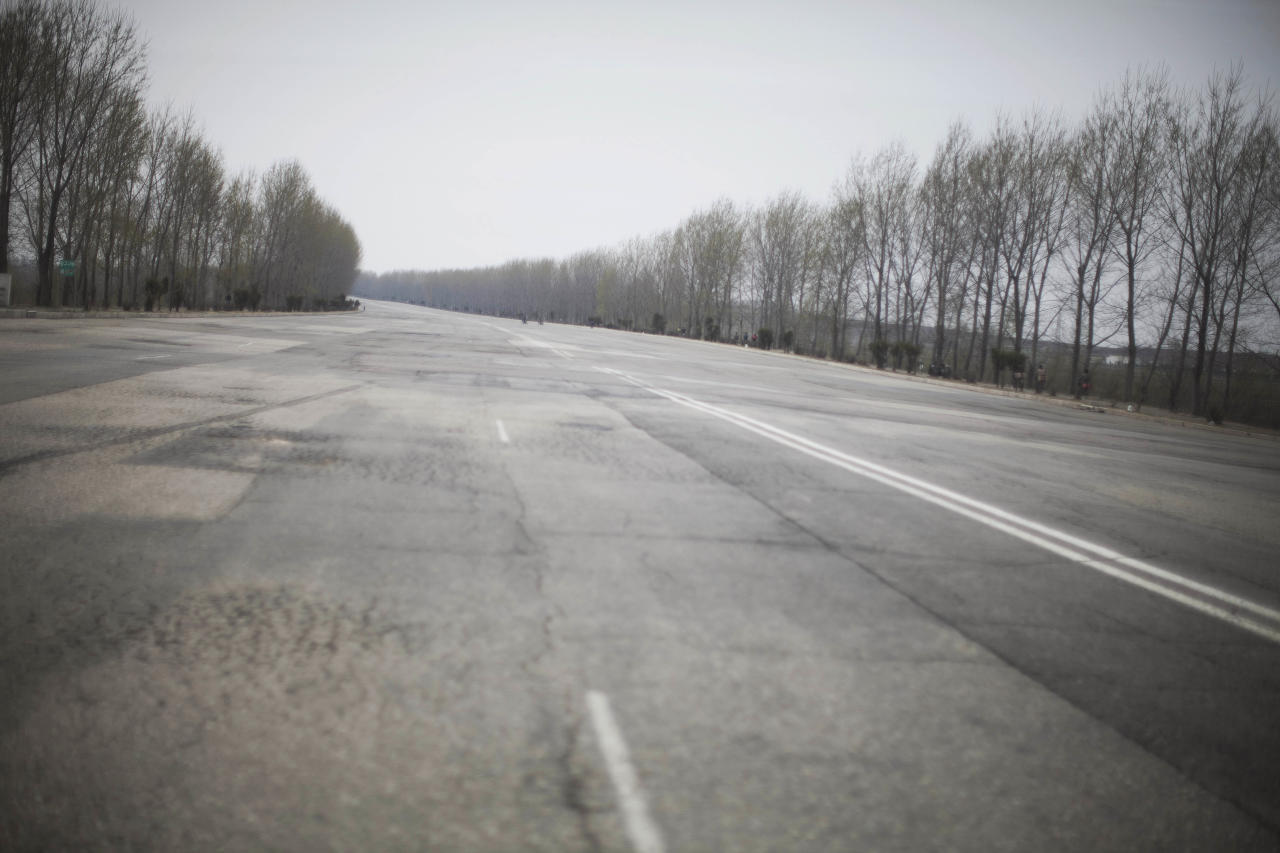 This April 21, 2011 photo shows a multi-lane highway empty of vehicles near Pyongyang, North Korea. (AP Photo/David Guttenfelder)