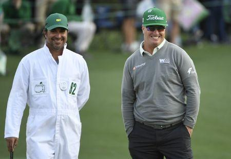 Apr 6, 2017; Augusta, GA, USA; Charley Hoffman and caddie Brett Waldman smile on the 18th green during the first round of The Masters golf tournament at Augusta National Golf Club. Mandatory Credit: Michael Madrid-USA TODAY Sports