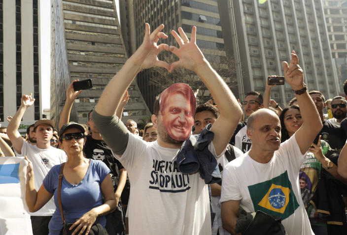 Supporters of Jair Bolsonaro, a presidential candidate who survived being stabbed during a campaign event days ago, march along Paulista Avenue to show support for the National Social Liberal Party candidate in Sao Paulo, Brazil, Sunday, Sept. 9, 2018. Brazil will hold general elections on Oct. 7. (AP Photo/Andre Penner)