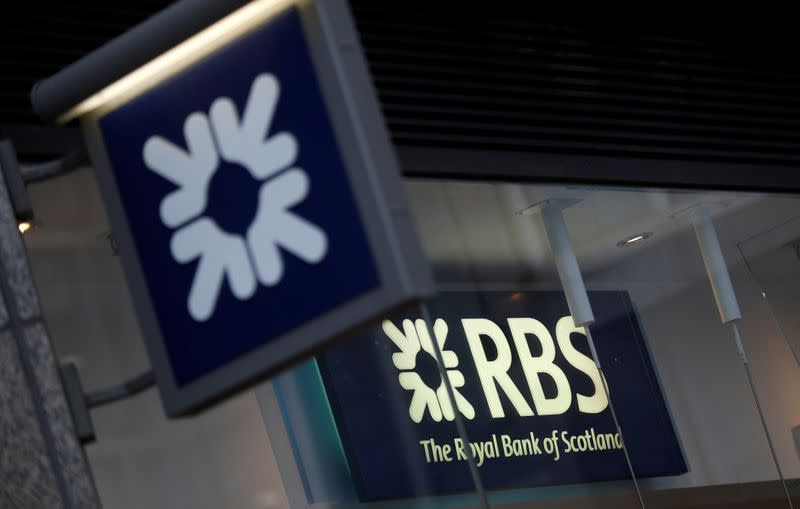 FILE PHOTO: Royal Bank of Scotland signs are seen at a branch of the bank, in London