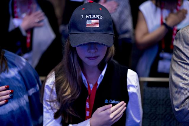"<p>An attendee wears an ""I Stand"" hat during the Pledge of Allegiance at the Conservative Political Action Conference (CPAC) in National Harbor, Md., on Thursday, Feb. 22, 2018. (Photo: Andrew Harrer/Bloomberg via Getty Images) </p>"