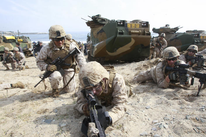 U.S. Marines aim their machine guns during the U.S.-South Korea joint landing exercises called Ssangyong, part of the Foal Eagle military exercises, in Pohang, South Korea, Monday, March 31, 2014. South Korea said North Korea has announced plans to conduct live-fire drills near the rivals' disputed western sea boundary. The planned drills Monday come after an increase in threatening rhetoric from Pyongyang and a series of rocket and ballistic missile launches in an apparent protest against the annual military exercises by Seoul and Washington. (AP Photo/Ahn Young-joon)