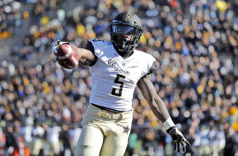 FILE - In this Nov. 10, 2018, file photo, Vanderbilt running back Ke'Shawn Vaughn celebrates as he runs into the end zone after catching a pass for a touchdown during the first half of an NCAA college football game against Missouri, in Columbia, Mo. Vaughn was named newcomer of the year on The Associated Press All-Southeastern Conference team, announced Monday, Dec. 3, 2018. (AP Photo/Jeff Roberson, File)