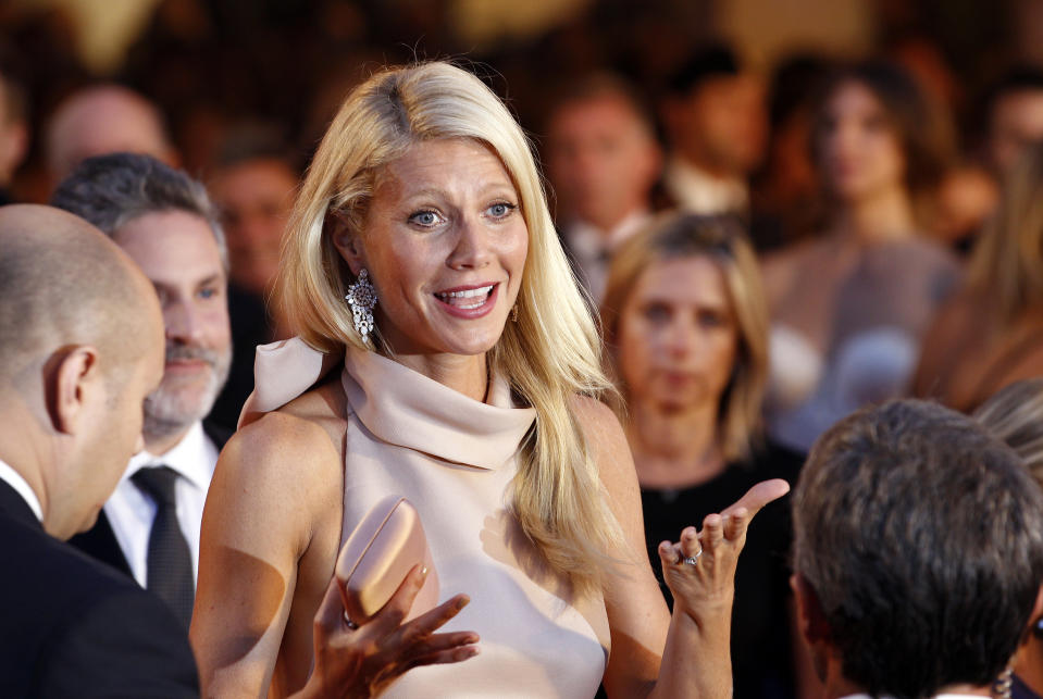"""Actress Gwyneth Paltrow, cast member of the movie """"Contagion"""", reacts on the red carpet at Cinema Palace during the 68th Venice Film Festival September 3, 2011. REUTERS/Alessandro Bianchi (ITALY - Tags: ENTERTAINMENT)"""