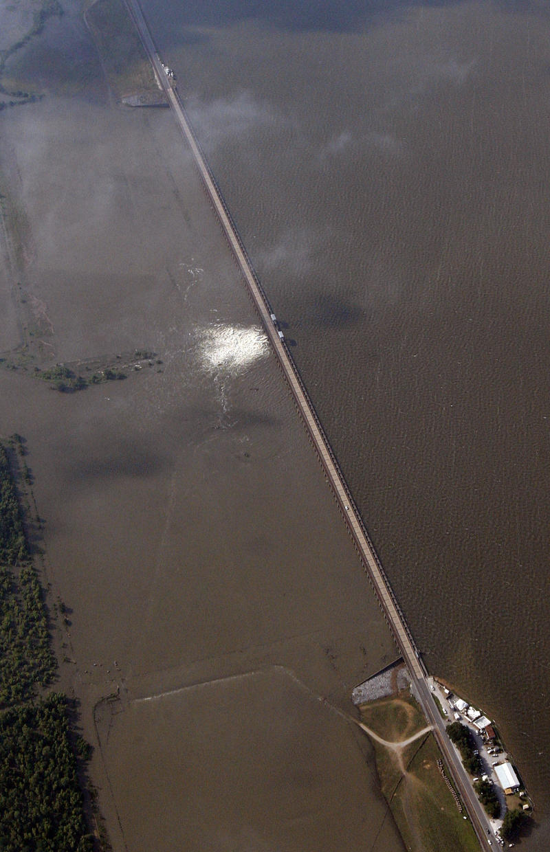 Water diverted from the Mississippi River spills through a bay in the Morganza Spillway in Morganza, La., Saturday, May 14, 2011. Water from the inflated Mississippi River gushed through a floodgate Saturday for the first time in nearly four decades and headed toward thousands of homes and farmland in the Cajun countryside, threatening to slowly submerge the land under water up to 25 feet deep. (AP Photo/Patrick Semansky)