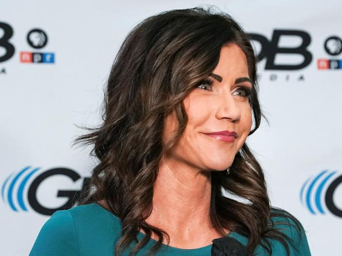 <p>South Dakota governor Kristi Noem posted a photo of her posing with a flamethrower.</p> (REUTERS)