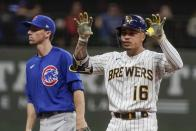 Milwaukee Brewers' Kolten Wong reacts to his double in front of Chicago Cubs' Matt Duffy during the fourth inning of a baseball game Friday, Sept. 17, 2021, in Milwaukee. (AP Photo/Morry Gash)