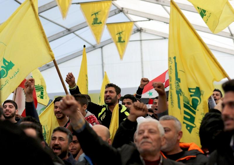 Supporters of Lebanon's militant Shiite movement Hezbollah chant slogans during a televised speech by Hassan Nasrallah, the head of Hezbollah, in the southern town of Insar, in the Nabatiyeh district on March 6, 2016 (AFP Photo/Mahmoud Zayyat)