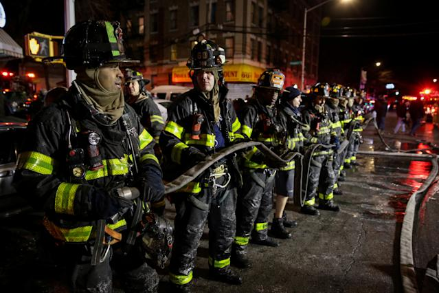 <p>Fire Department of New York (FDNY) personnel work on the scene of an apartment fire in Bronx, New York, Dec. 28, 2017. (Photo: Amr Alfiky/Reuters) </p>