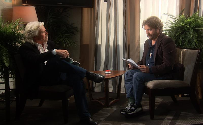 "In this undated image from video released by Comedy Central, host Zach Galifianakis, right, talks with billionaire businessman Richard Branson from, ""Between Two Ferns: A Fairytale of New York"" a 30-minute special premiering on Sunday, May 6 at 8:30 p.m. EST on Comedy Central. (AP Photo/Comedy Central)"
