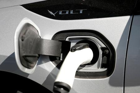 FILE PHOTO: A Chevrolet Volt plug-in hybrid vehicle is being charged at Stewart Chevrolet in Colma, California, U.S., October 3, 2017. REUTERS/Stephen Lam/File Photo