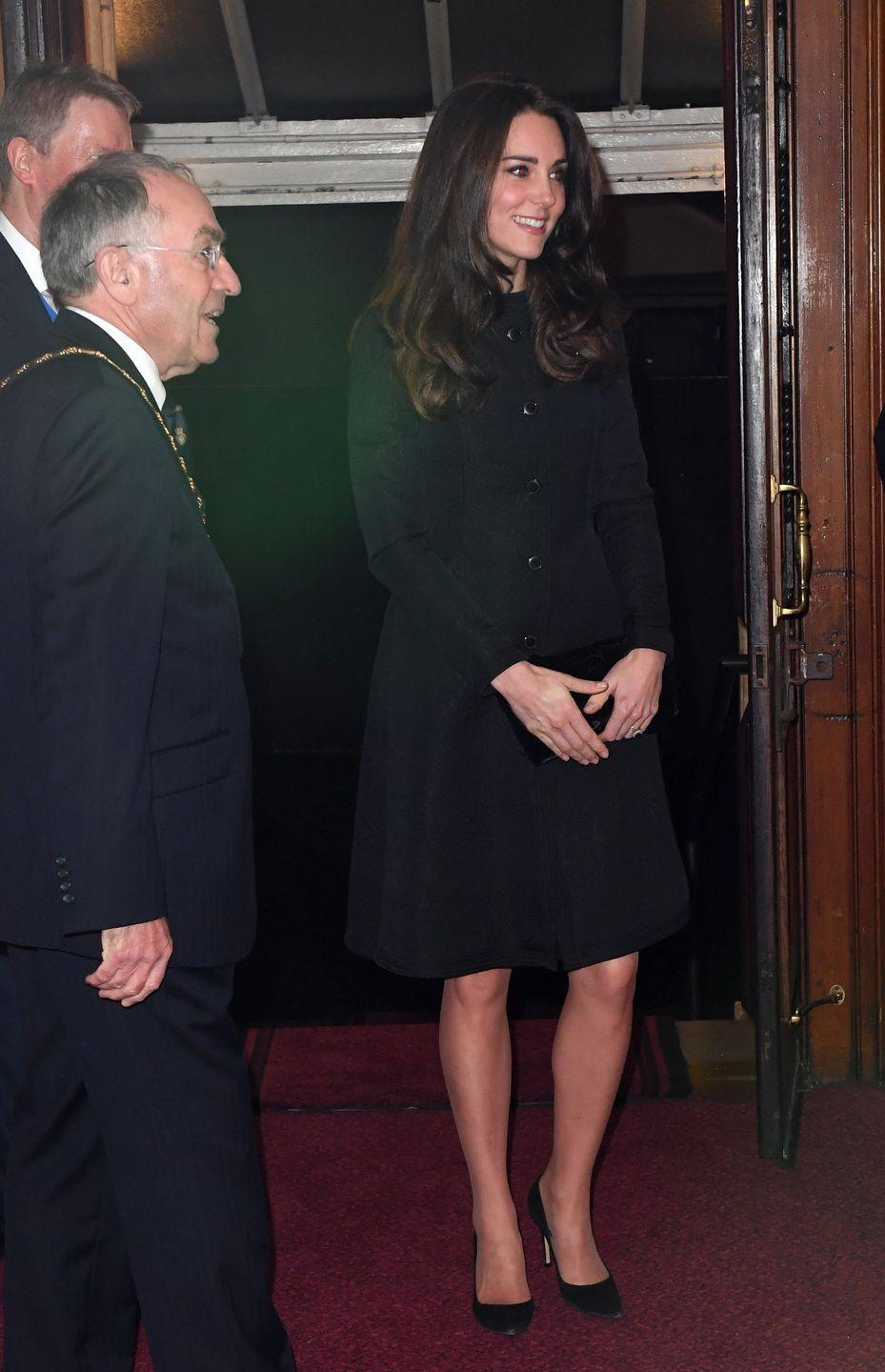 <p>The Duchess looked modest yet sophisticated in a black Temperley London coat and classic black pumps at the Royal Festival of Remembrance at London's Royal Albert Hall. </p>