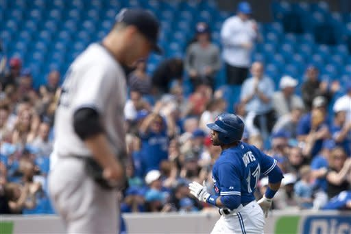 Toronto Blue Jays' Rajai Davis rounds the bases after hitting a home run off New York Yankees starting pitcher Andy Pettite, left, during the first inning of a baseball game in Toronto, Saturday, Sept. 29, 2012. (AP Photo/The Canadian Press, Chris Young)