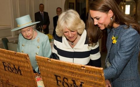 The Queen, Duchess of Cornwall and Duchess of Cambridge at Fortnum and Mason in 2012 - Credit: AFP
