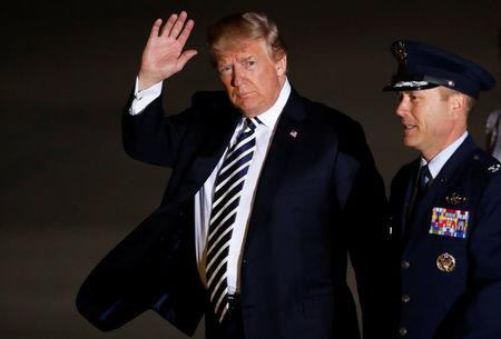 President Donald Trump waves as he arrives to greet the three Americans formerly held hostage in North Korea, at Joint Base Andrews, Maryland, U.S., May 10, 2018. REUTERS/Jim Bourg