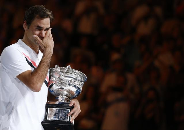 Tennis - Australian Open - Men's singles final - Rod Laver Arena, Melbourne, Australia, January 28, 2018. Winner Roger Federer of Switzerland cries while holding the trophy. REUTERS/Thomas Peter TPX IMAGES OF THE DAY