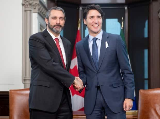 Yukon Premier Sandy Silver with Prime Minister Justin Trudeau in 2019. The Liberals hold Yukon's seat at the federal level, while the Yukon Liberals have governed the territory since 2016. (Adrian Wyld / Canadian Press - image credit)