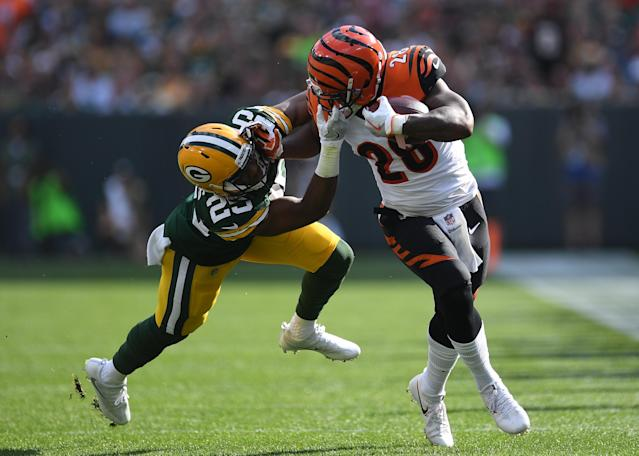 <p>Marwin Evans #25 of the Green Bay Packers grabs the face mask of Joe Mixon #28 of the Cincinnati Bengals trying to make a tackle during the first quarter of their game at Lambeau Field on September 24, 2017 in Green Bay, Wisconsin. (Photo by Stacy Revere/Getty Images) </p>