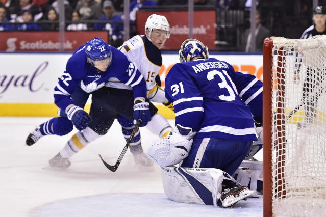 Buffalo Sabres centre Jack Eichel (15) scores against Toronto Maple Leafs goaltender Frederik Andersen (31) as defenceman Nikita Zaitsev (22) defends during third period NHL hockey action in Toronto on Monday, March 26, 2018. (Frank Gunn/The Canadian Press via AP)