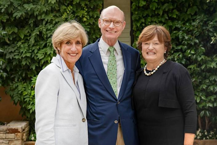 Walter Hussman (center) and his wife, Ben, (right) meet with Susan King, the dean of UNC's School of Media and Journalism (left). The School of Media and Journalism will now be known as the Hussman School of Journalism and Media following a $25 million gift by alumnus Walter Hussman.