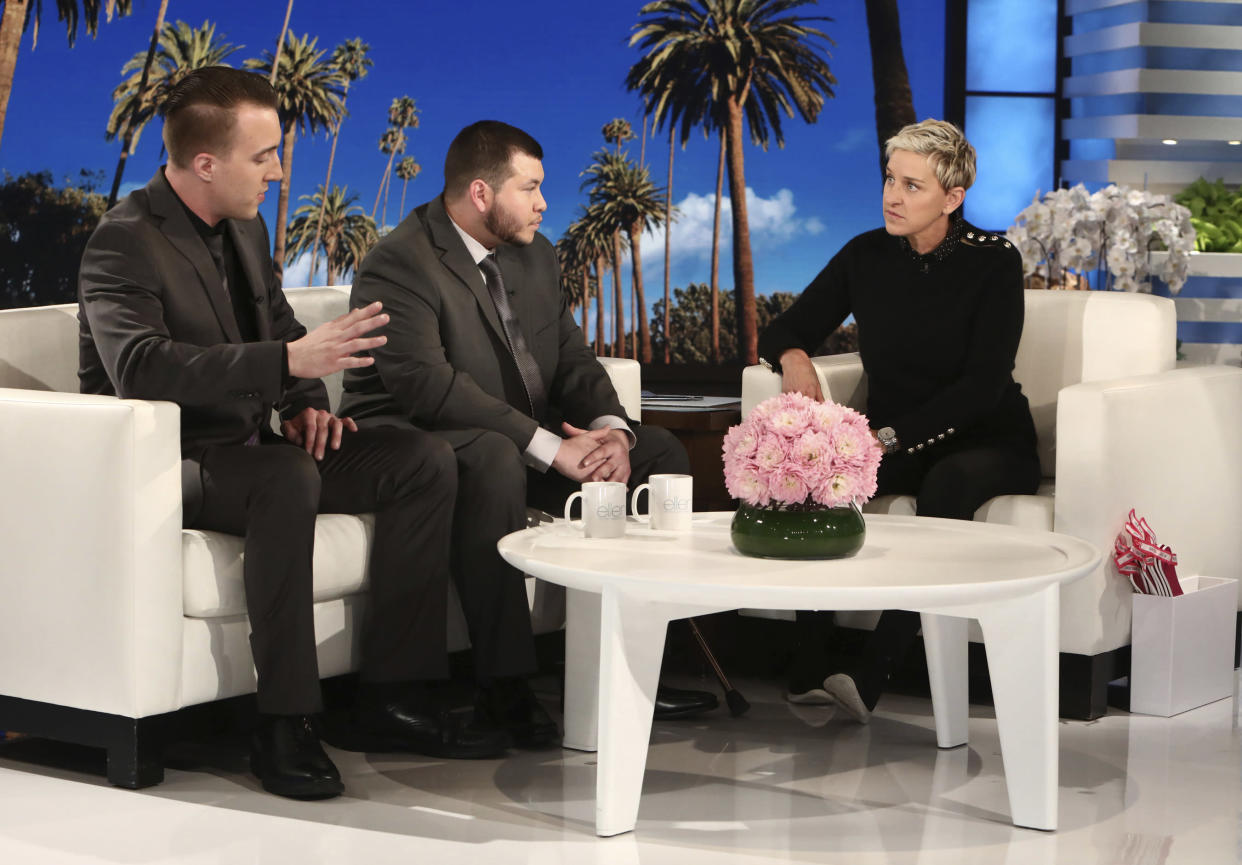 """Stephen Schuck, left, and Jesus Campos sit with host Ellen Degeneres during a taping of """"The Ellen DeGeneres Show"""" at the Warner Bros. lot in Burbank, Calif., on Oct. 17, 2017. Schuck, a building engineer, and Campos, a security guard, were working at the Mandalay Bay Resort and Casino the night of the mass shooting on Oct. 1. Campos was shot by gunman Stephen Paddock. (Photo: Michael Rozman/Warner Bros./AP)"""