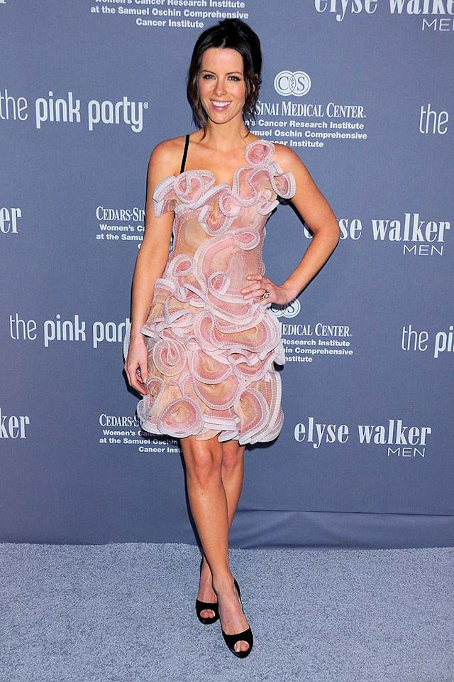 """Kate Beckinsale pops a pose in a ravishing rose cocktail dress. Unfortunately, her hair is a hot mess. Gregg DeGuire/<a href=""""http://www.wireimage.com"""" target=""""new"""">WireImage.com</a> - September 13, 2008"""