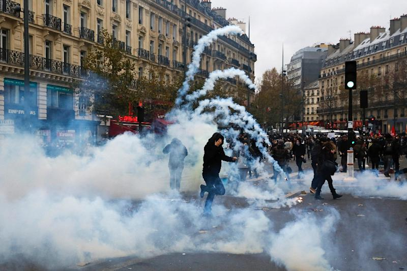 Protestors clash with riot police during a rally against global warming on November 29, 2015 in Paris, a day ahead of the start of UN conference on climate change COP21