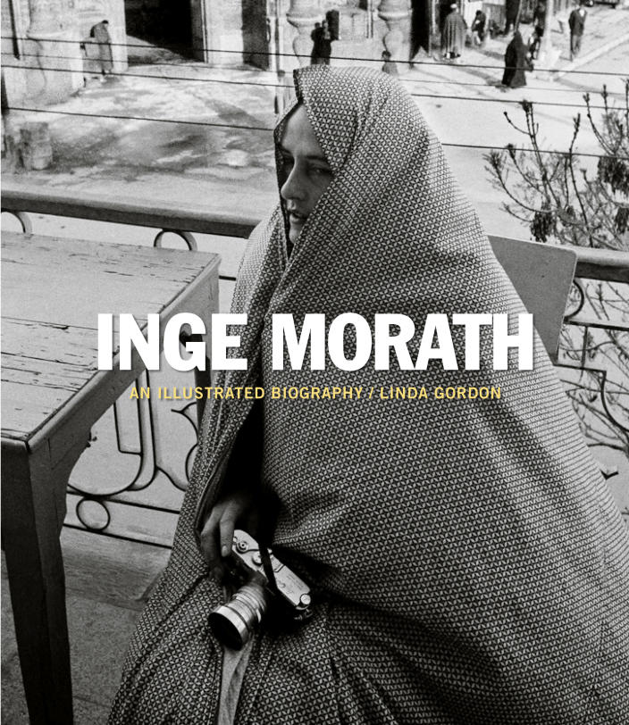 <p>Book jacket shows Inge Morath with the entrance to the Shrine of Fatema in the background in Qom, Iran, 1956. (© Inge Morath/Magnum Photos from the book <em>Inge Morath: An Illustrated Biography</em> by Linda Gordon, published by Prestel) </p>