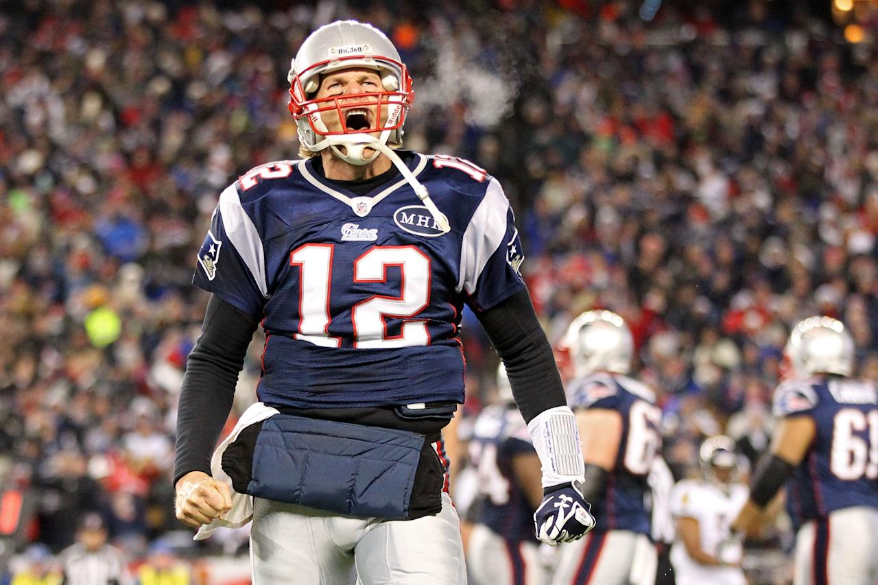 FOXBORO, MA - JANUARY 22:  Tom Brady #12 of the New England Patriots celebrates after scoring a touchdown in the fourth quarter against the Baltimore Ravens during their AFC Championship Game at Gillette Stadium on January 22, 2012 in Foxboro, Massachusetts.  (Photo by Jim Rogash/Getty Images)