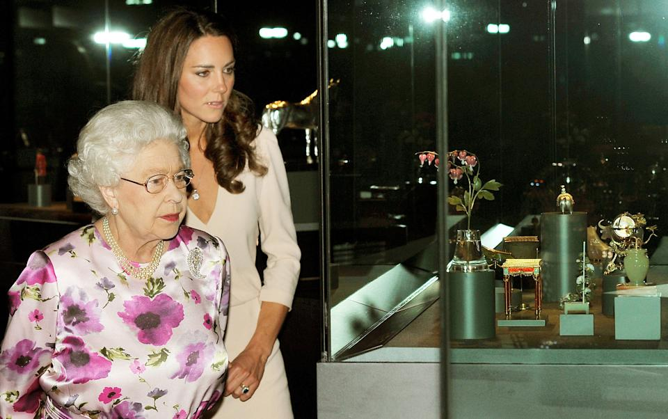 LONDON, UNITED KINGDOM - JULY 22:  Queen Elizabeth ll and Catherine, Duchess of Cambridge view a display of items for the Duke and Duchess of Cambridge's wedding on display at Buckingham Palace for the annual summer opening on July 22, 2011 in London, England. (Photo by Rota/Anwar Hussein Collection/Getty Images)