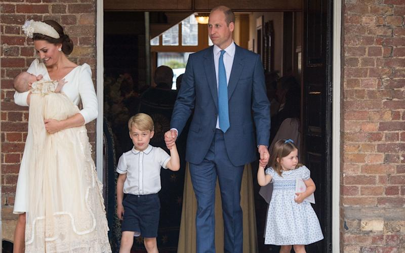 The Cambridge family at Prince Louis' christening - PA