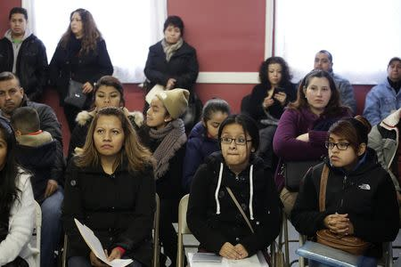 Migrants attend a workshop for legal advice held by the Familia Latina Unida and Centro Sin Fronteras at Lincoln United Methodist Church in south Chicago