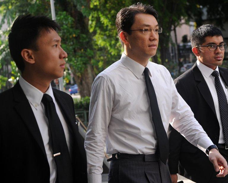Law professor Tey Tsun Hang (C) arrives at court in Singapore on June 3, 2013