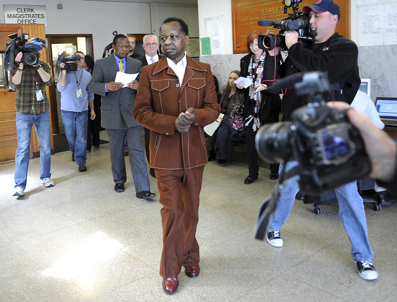Onyango Obama, the uncle of President Barack Obama, leaves Framingham, Mass., District Court after his appearance Tuesday, March 27, 2012.  A Massachusetts drunken driving charge against him from an incident in August 2011 will be dismissed if he stays out of trouble for a year, officials said. Obama did not plead guilty, but acknowledged Massachusetts prosecutors had enough evidence to convict him. (AP Photo/MetroWest Daily News, Allan Jung)