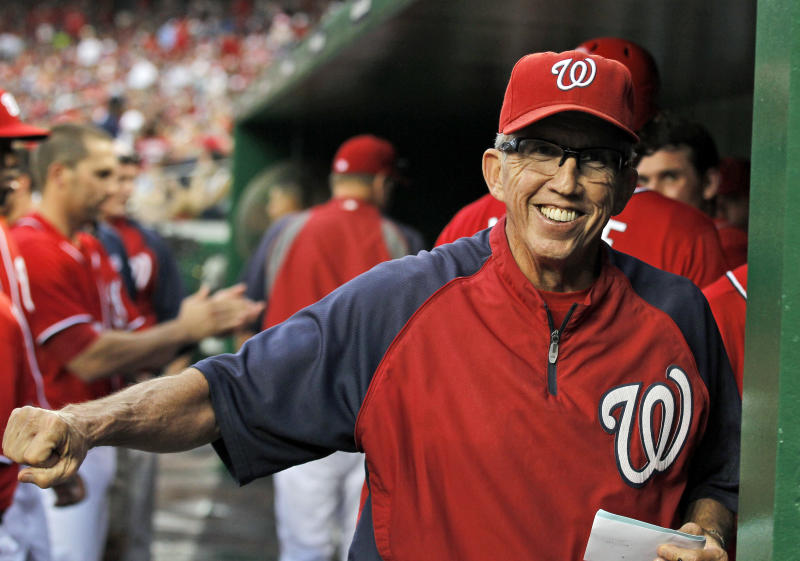 FILE - In this Sept. 1, 2012,, file photo, Washington Nationals manager Davey Johnson smiles in the dugout during a baseball game against the St. Louis Cardinals at Nationals Park in Washington.  Johnson was voted as the National League Manager of the Year on Tuesday, Nov. 13, 2012. (AP Photo/Alex Brandon, File)
